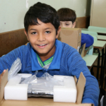 Aluno da rede municipal recebe netbook - Cadini / Secretaria Municipal de Educação de Cascavel